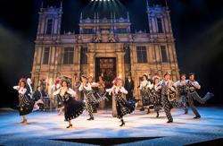 Picture of the company on dancing on stage at Chichester Festival Theatre