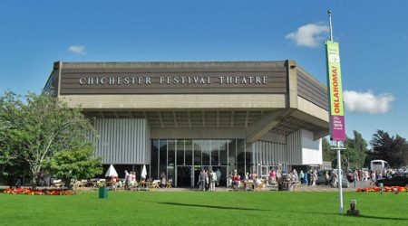 Picture of the outside of Chichester Festival Theatre in the sunshine