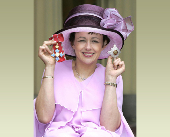 Dame Tanni Grey_thompson at Buckingham palace wearing purple